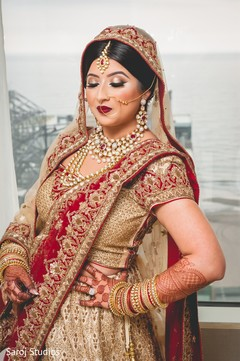 Details of makeup and mehndi design on the Indian bride