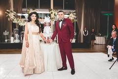 Maharani and Raja holding hands at the reception