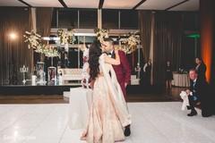 Indian groom and maharani kissing at the reception
