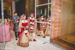 Beautiful Indian newlyweds making their exit