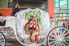 Indian bride and groom in their fantastic carriage
