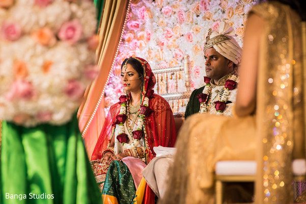 See this couple during traditional wedding ritual.