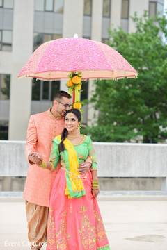 Indian bride and groom on their marvelous sangeet outfits.