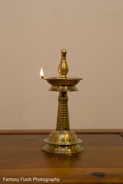 Close Up shot on Oil lamps at Indian wedding ceremony.