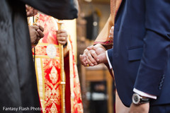 Indian bride and groom holding hands closeup capture.