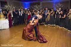 Sweet kiss of Indian couple having their first dance.