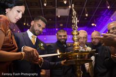 Maharani and raja lighting up the fire.