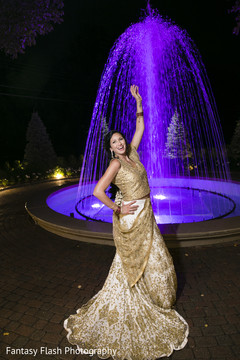Charming Indian bride posing on her reception outfit.