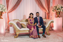 Sweet indian couple posing for photo shoot.