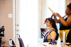 Indian bridesmaid getting her hair done.