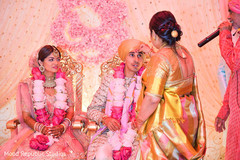 Indian bride and groom during a moment of the rituals