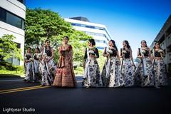 Beautiful Indian bridesmaids posing with Maharani
