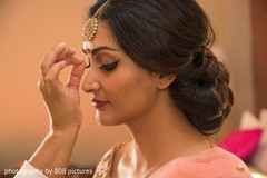 Stunning maharani being assisted by makeup artist