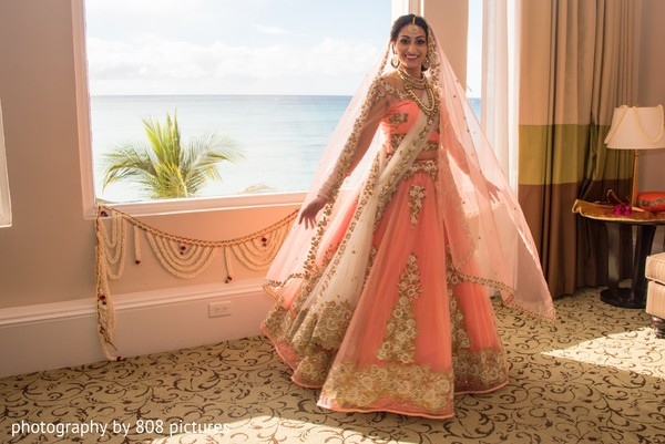 Dazzling Indian bride posing by the sea