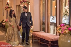 Beautiful shot of Indian bride and groom holding hands