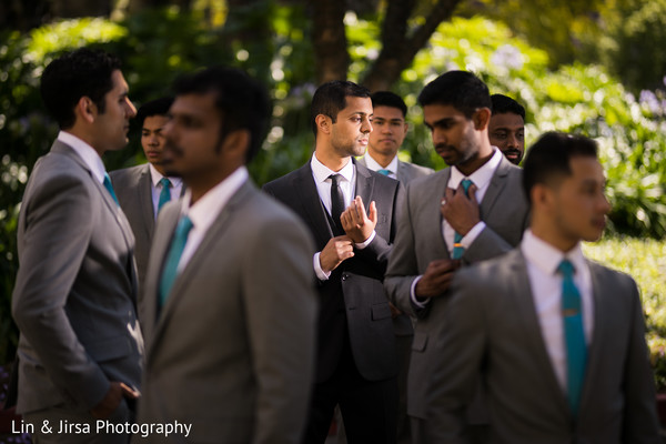 Indian groom preparing for the ceremony with the groomsmen
