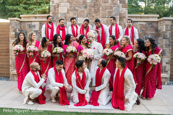 Dazzling capture of Indian couple with bridesmaids and groomsmen
