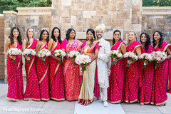 Ravishing bridesmaids posing for the Indian couple
