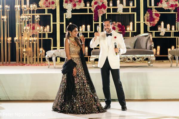 Indian newlyweds making a toast