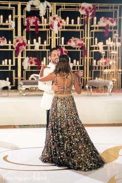 Raja dancing with his wife at the reception