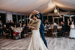 Indian newlyweds enjoying their first dance at the reception venue