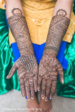 Marvelous Indian bride mehndi art done on her hands.