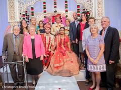 stunning Indian wedding ceremony family portrait.