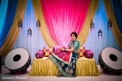 Impressive indian bride posing for photoshoot.