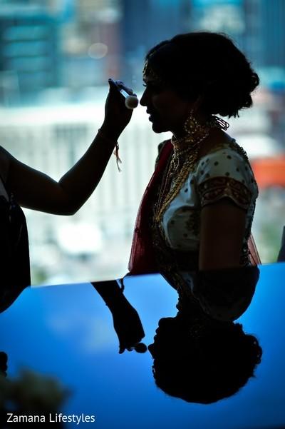 Wonderful silhouette of maharani getting her makeup done.
