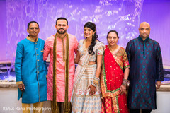 Indian bride and groom with family members