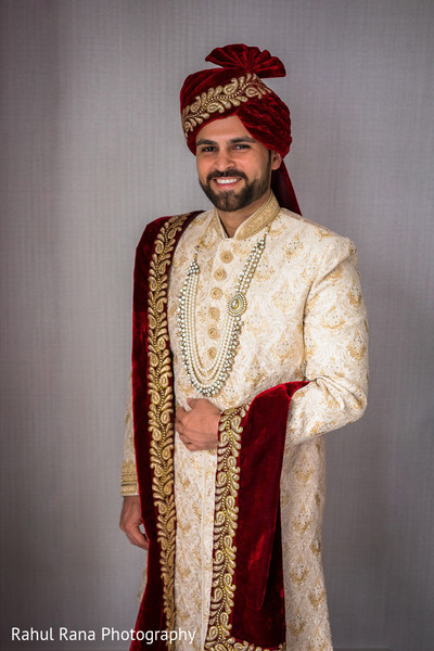 Indian groom posing for portraits