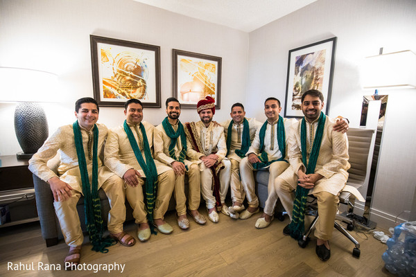 Indian groomsmen getting ready for the ceremony