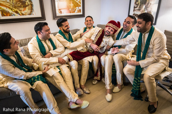 Fun capture of raja getting ready for the ceremony with groomsmen
