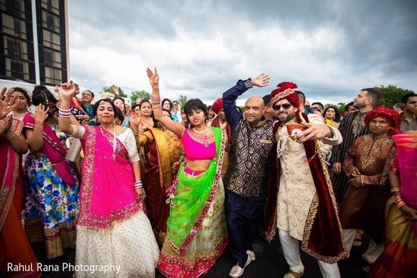 Indian groom having a blast during the baraat