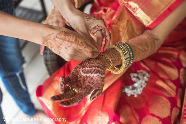 Maharani getting her bracelets on.
