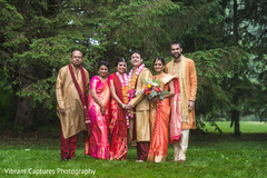 Charming Indian bride and groom  with wedding guests.