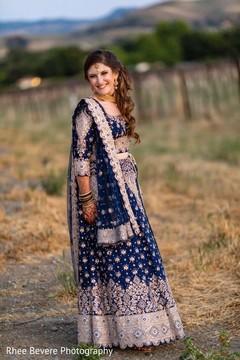 Glowing bride on her Indian wedding reception fashion.