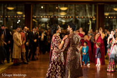 Guests observe as the Indian newlyweds have their first dance