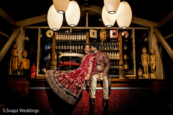 Maharani and Indian groom posing in the venue for pictures