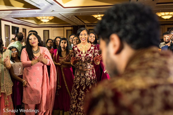 Indian bride cheering for the Indian groom