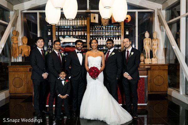 Glamorous Indian bride and groom with groomsmen portrait.