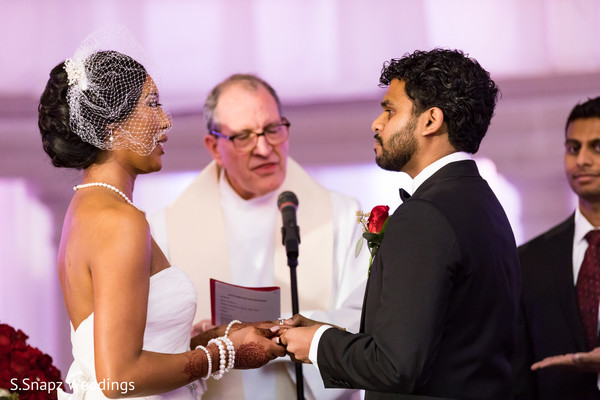 Indian couple exchanging wedding vows.