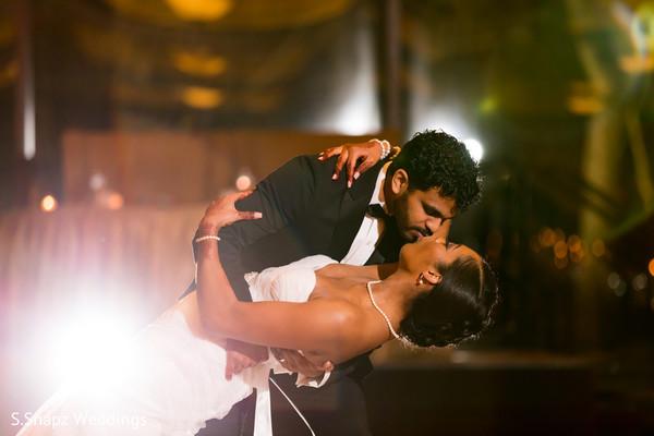 Sweet shot of Indian couple kiss.