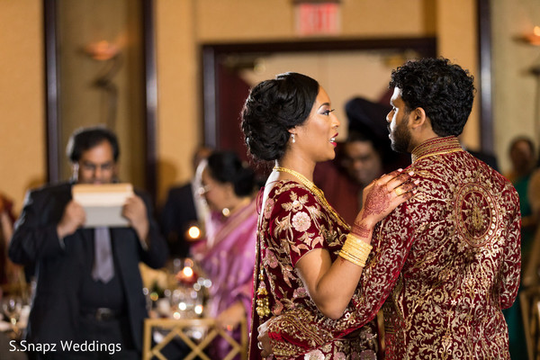 Gorgeus Indian bride and groom at their reception dance.