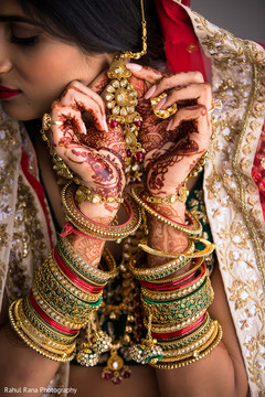 Beautiful maharani showing her jewelry and mehndi