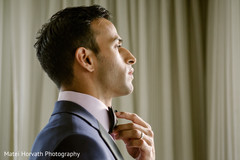Indian groom getting ready photo.