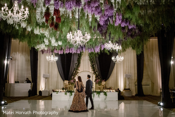 Dreamy Indian wedding reception dance floor and stage decoration.