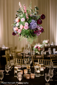 Fascinating Indian wedding wedding table flowers decoration.