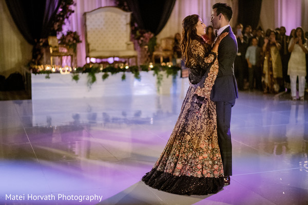 Lovely Indian couple enjoying their first dance capture.