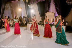 Indian bridesmaids dancing on their wedding reception party.